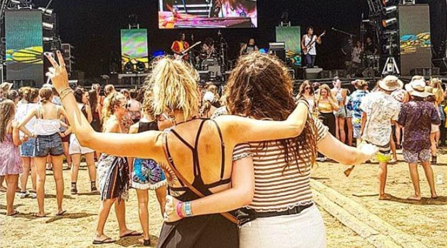 two girls watching a concert